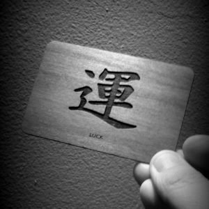 image of a woodenbetonit card with Japanese symbol for Luck