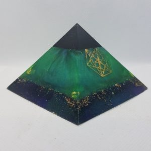 Transformation Orgonite Orgone Pyramid 9.5cm - Sacred Geometry and Shungite, this is a show stopper of power. Within the Shungite is Herkimer Diamonds, a rose quartz chuck and 4 quartz points to assist with emf protection