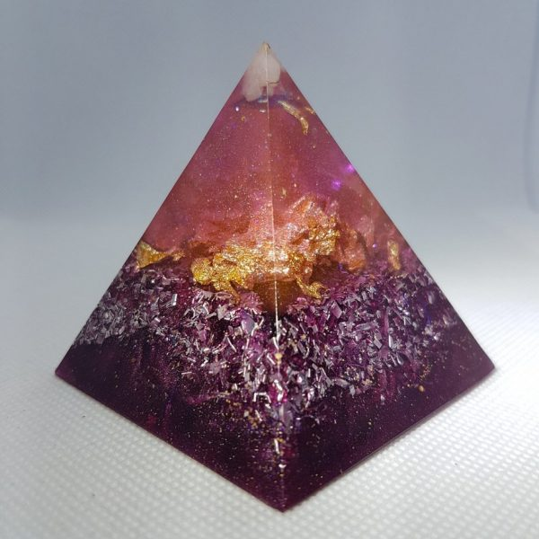 Mauve Perfection Orgone Orgonite Pyramid 6cm -Moonstone, Howlite and Herkimer Diamonds, layer of gold, with clear quartz for clarity and then silver and aluminium as the base.