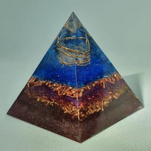 Levels of Illusion Orgone Orgonite Pyramid 6cm - The power of Clear Quartz Point wrapped int Copper on a base of more copper and brass for emf protection, with small rose quartz mixed in for love!